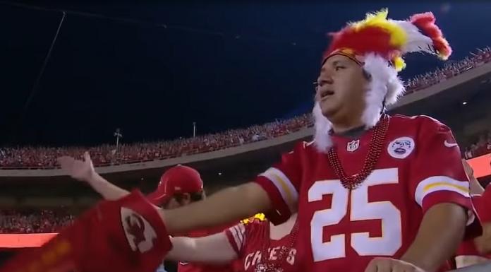 Kansas City Chiefs fans do the tomahawk chop.