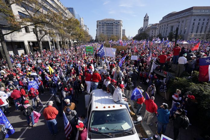AP Photo: Supporters of President Donald Trump rally at Freedom Plaza.